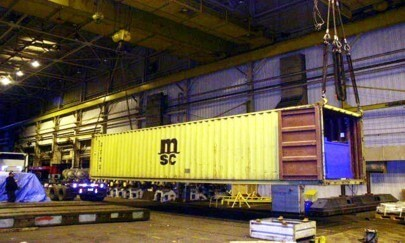 large shipping container being loaded